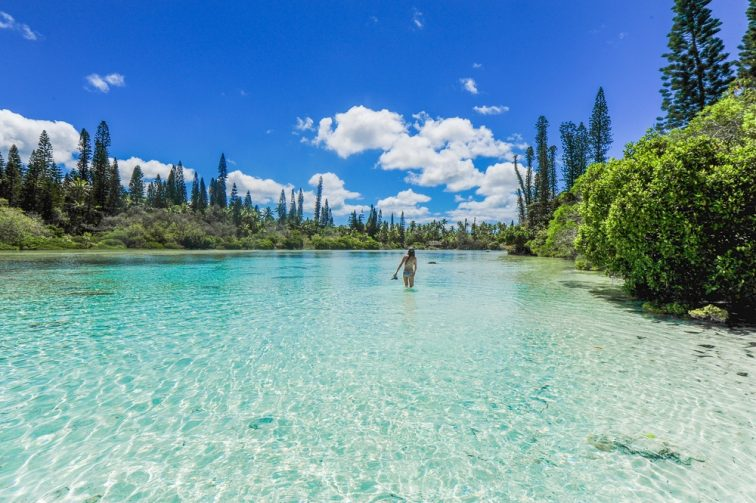 A girl standing in the lake New Caledonia