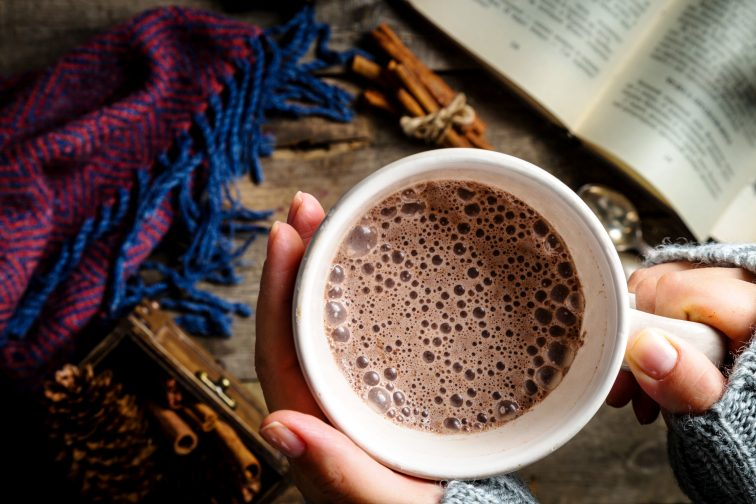Winter hot chocolate on rustic background, copy space