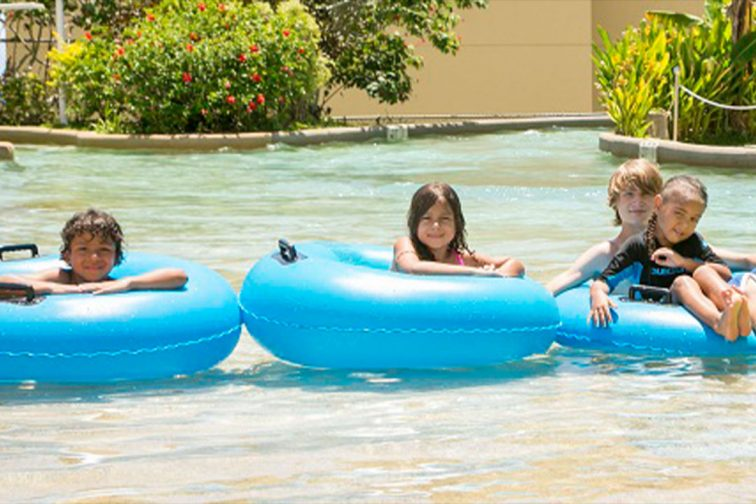 guam plaza pool children playing at the pool