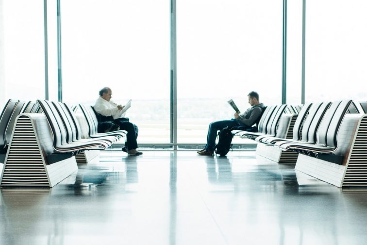 airport 2 people seating at the bench