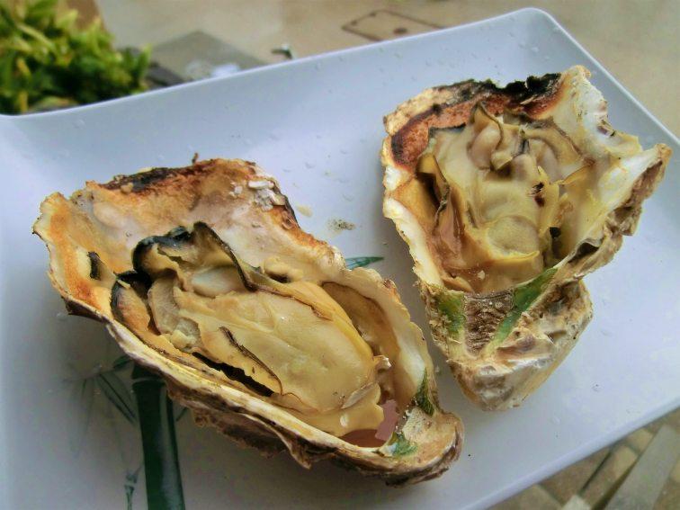 Grilled,Oysters,On,Itsukushima,Island,,Miyajima,,Hiroshima,,Japan